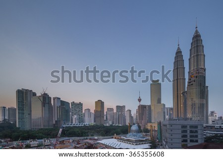 KUALA LUMPUR, MALAYSIA - MAY 30 2015:The Petronas Twin Tower and the construction nearby views from the Zon Residence Hotel