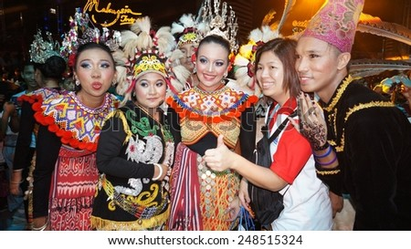 KUALA LUMPUR, MALAYSIA-MAY 25:Tourist and unidentified Malaysians dancer during the Festival Colours of 1 Malaysia May 25, 2013 in Kuala Lumpur Malaysia. 25.72million tourist visited Malaysia in 2013.