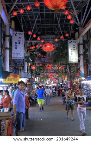 KUALA LUMPUR MALAYSIA - 24 May, 2014: Unidentified people shop at China town. China town, also known as Petaling street is a popular tourist destination and has dozens of restaurants and food stalls.
