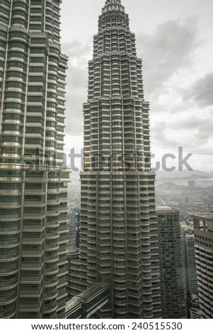 KUALA LUMPUR, MALAYSIA - NOV 16: Petronas Towers on a sunny day on October 26, 2014 in Kuala Lumpur, Malaysia.Petronas Towers were the tallest buildings in the world from 1998 to 2004. - stock photo