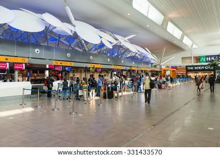 KUALA LUMPUR, MALAYSIA - 02 NOV 2014: Travellers queued up at the check in counter of Kuala Lumpur International Airport KLIA2 in Malaysia. - stock photo