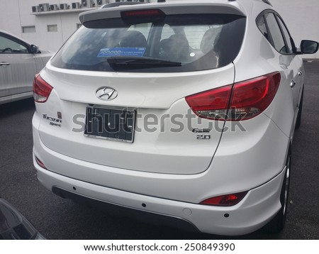 KUALA LUMPUR, MALAYSIA - NOVEMBER 16, 2014 : Hyundai Tucson 2014 on display at a local car dealer in Kuala Lumpur, Malaysia. Hyundai Motor Company is based in Seoul, South Korea. - stock photo
