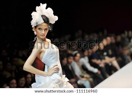 KUALA LUMPUR, MALAYSIA - NOVEMBER 8: Model presents creation by Hatta Dolmat during Malaysia-International Fashion Week on November 8, 2009 in Kuala Lumpur, Malaysia. - stock photo