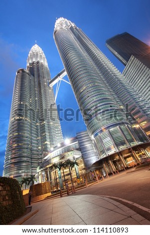 KUALA LUMPUR, MALAYSIA - NOVEMBER 30: Night time of Petronas Twin Towers on November 30, 2011 in Kuala Lumpur, Malaysia. This building (451.9m/88 floors) is the tallest twin buildings in the world.