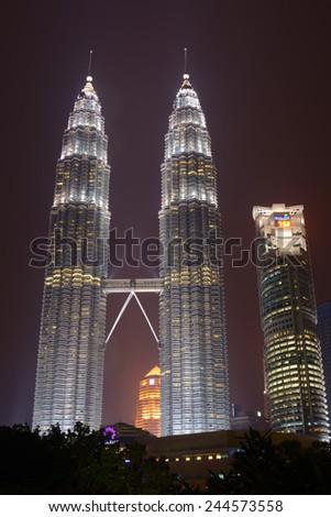 Kuala Lumpur, Malaysia - November 5, 2014: 88-storey Petronas Twin Towers - the main attraction of Kuala Lumpur in night scene. - stock photo