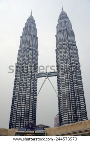 Kuala Lumpur, Malaysia - November 5, 2014: 88-storey Petronas Twin Towers - the main attraction of Kuala Lumpur. This is the highest twin towers in the world. - stock photo