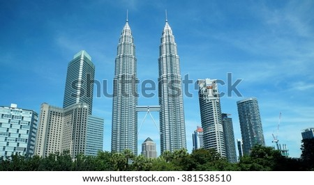 KUALA LUMPUR, MALAYSIA - NOVEMBER 22, 2015: The Petronas Twin Towers at KLCC City Center on a clear day and blue. - stock photo