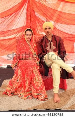 KUALA LUMPUR, MALAYSIA - NOVEMBER 28: The Punjab Couple wearing exotic traditional cloth at the Malaysia Wedding Exhibition on NOVEMBER 28, 2010 in KUALA LUMPUR, MALAYSIA - stock photo