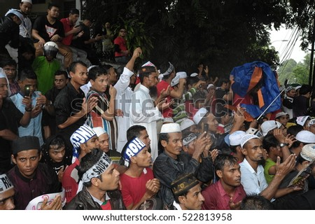 KUALA LUMPUR, MALAYSIA - NOVEMBER 25 2016: Unknown protesters of Malaysian and Rohingya people make a prayer in a peaceful rally march their way to Myanmar Embassy in Kuala Lumpur, Malaysia.