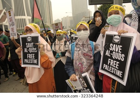 KUALA LUMPUR, MALAYSIA - OCT 2: Malaysian young girl muslim holding placard during peaceful demonstration outside of US embassy in Kuala Lumpur, Malaysia on October 2, 2015.