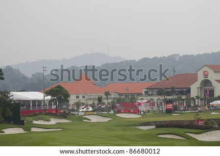 KUALA LUMPUR, MALAYSIA - OCTOBER 15: A view of the 18th hole and clubhouse after rain stopped play on Day 3 of Sime Darby LPGA Golf October 15, 2011 in Kuala Lumpur, Malaysia.