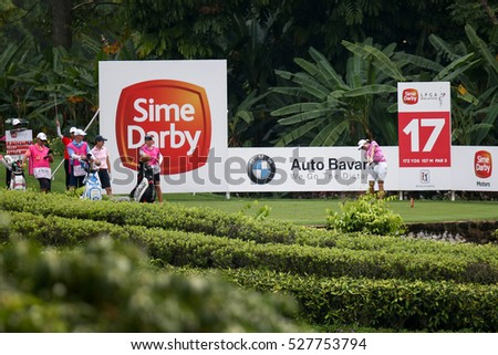KUALA LUMPUR, MALAYSIA - OCTOBER 29, 2016: Alena Sharp of Canada tees off from the T-box of the 17th hole at the TPC Golf Course at the 2016 Sime Darby LPGA Malaysia golf tournament.