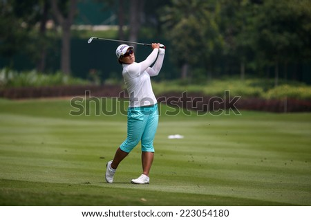 KUALA LUMPUR, MALAYSIA - OCTOBER 10, 2014: Amy Yang of South Korea plays on the fairway of the ninth hole of the KL Golf & Country Club at the 2014 Sime Darby LPGA Malaysia golf tournament. - stock photo