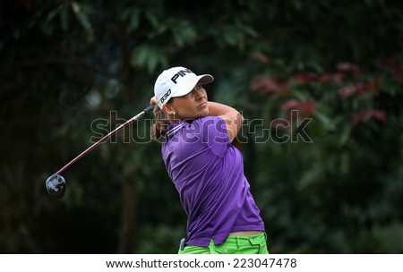 KUALA LUMPUR, MALAYSIA - OCTOBER 11, 2014: Angela Stanford of the USA tees off at the fourth hole of the KL Golf & Country Club during the 2014 Sime Darby LPGA Malaysia golf tournament. - stock photo