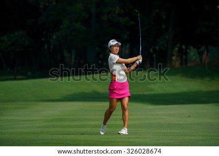 KUALA LUMPUR, MALAYSIA - OCTOBER 09, 2015: Australia's Minjee Lee reacts after her play from 6th hole fairway at the KL and Golf & Country Club at the 2015 Sime Darby LPGA Malaysia golf tournament. - stock photo