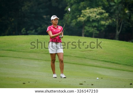 KUALA LUMPUR, MALAYSIA - OCTOBER 10, 2015: Australia's Minjee Lee tees off at the sixth hole of the KL Golf & Country Club on Round 3 day at the 2015 Sime Darby LPGA Malaysia golf tournament.  - stock photo