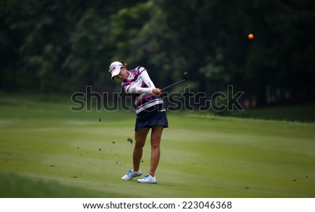 KUALA LUMPUR, MALAYSIA - OCTOBER 11, 2014: Chella Choi of South Korea makes a shot from the fairway of the ninth hole of the KLGC Club during the 2014 Sime Darby LPGA Malaysia golf tournament. - stock photo