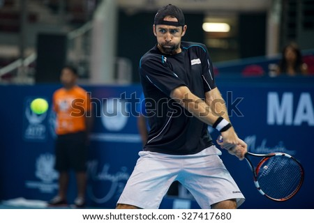 KUALA LUMPUR, MALAYSIA - OCTOBER 03, 2015: Germany's tennis player Benjamin Becker plays a backhand return at the 2015 Malaysian Open tennis tournament from Sep 26 - Oct 4, 2015 in Stadium Putra. - stock photo