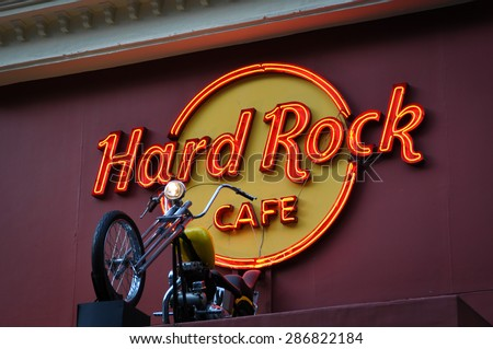 KUALA LUMPUR, MALAYSIA - 7 OCTOBER 2012: Hard Rock Cafe and motorbike display. Hard Rock Cafe is an American chain of theme restaurant founded in 1971.