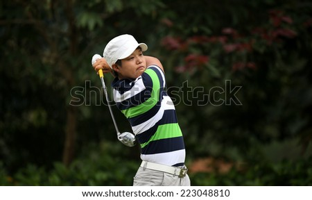 KUALA LUMPUR, MALAYSIA - OCTOBER 11, 2014: Haru Nomura of Japan tees off at the fourth hole of the KL Golf & Country Club during the 2014 Sime Darby LPGA Malaysia golf tournament. - stock photo