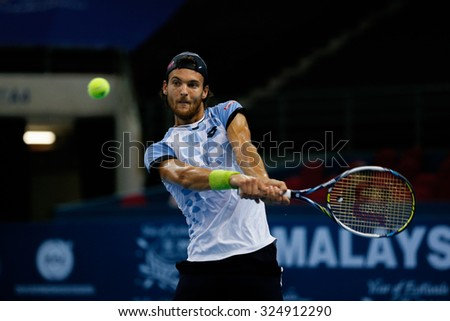 KUALA LUMPUR, MALAYSIA - OCTOBER 01, 2015: Joao Sousa of Portugal attempts a backhand return during his match at the Malaysian Open 2015 Tennis tournament held at the Putra Stadium, Malaysia.