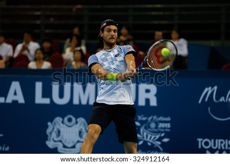 KUALA LUMPUR, MALAYSIA - OCTOBER 01, 2015: Joao Sousa of Portugal hits a backhand return during his match at the Malaysian Open 2015 Tennis tournament held at the Putra Stadium, Malaysia. - stock photo