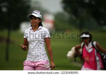 KUALA LUMPUR, MALAYSIA - OCTOBER 11, 2014: Julieta Granada of Paraguay reacts after her put at the third hole of the KL Golf & Country Club during the 2014 Sime Darby LPGA Malaysia got tournament. - stock photo