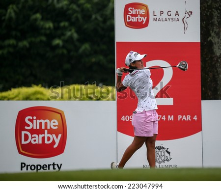 KUALA LUMPUR, MALAYSIA - OCTOBER 11, 2014: Julieta Granada of Paraguay tees off at the second hole of the KL Golf & Country Club during the 2014 Sime Darby LPGA Malaysia got tournament. - stock photo