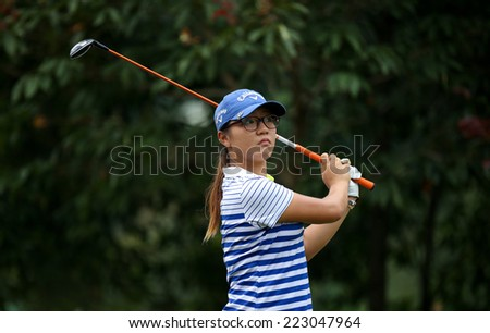 KUALA LUMPUR, MALAYSIA - OCTOBER 11, 2014: Lydia Ko of New Zealand reacts after  teeing off at the fourth hole of the KL Golf & Country Club during the 2014 Sime Darby LPGA Malaysia golf tournament. - stock photo