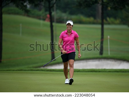 KUALA LUMPUR, MALAYSIA - OCTOBER 11, 2014: Marina Alex of the USA reacts after her put at the third hole of the KL Golf & Country Club during the 2014 Sime Darby LPGA Malaysia got tournament. - stock photo