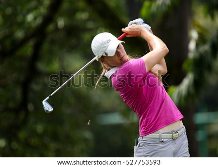 KUALA LUMPUR, MALAYSIA - OCTOBER 29, 2016: Maude-Aimee Leblanc of Canada tees off from the T-box of the 4th hole at the TPC Golf Course at the 2016 Sime Darby LPGA Malaysia golf tournament.