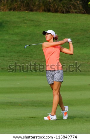 KUALA LUMPUR, MALAYSIA - OCTOBER 10: Michelle Wie of the USA drives the ball on the fairway of hole #11 during the Sime Darby LPGA 2012 golf tournament on Oct 10, 2012 in Kuala Lumpur, Malaysia. - stock photo