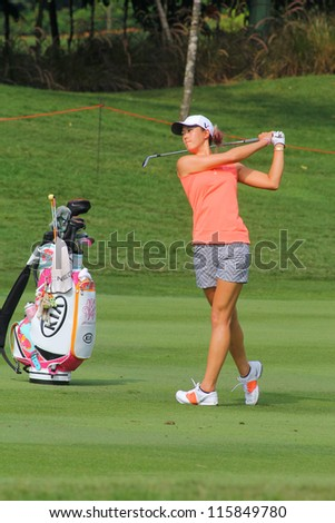 KUALA LUMPUR, MALAYSIA - OCTOBER 10: Michelle Wie of the USA drives the ball on the fairway of hole #6 during the Sime Darby LPGA 2012 golf tournament on Oct 10, 2012 in Kuala Lumpur, Malaysia. - stock photo