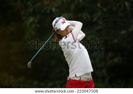 KUALA LUMPUR, MALAYSIA - OCTOBER 11, 2014: Na Yeon Choi of South Korea tees off at the fourth hole of the KL Golf & Country Club during the 2014 Sime Darby LPGA Malaysia golf tournament. - stock photo
