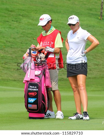 KUALA LUMPUR, MALAYSIA - OCTOBER 10: Paula Creamer of the USA prepares to play at the fairway of hole #6 during the Sime Darby LPGA 2012 golf tournament on Oct 10, 2012 in Kuala Lumpur, Malaysia. - stock photo