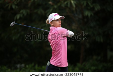 KUALA LUMPUR, MALAYSIA - OCTOBER 11, 2014: Pernila Lindberg of Sweden tees off at the fourth hole of the KL Golf & Country Club during the 2014 Sime Darby LPGA Malaysia golf tournament. - stock photo