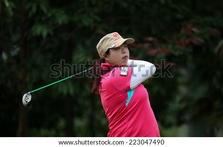 KUALA LUMPUR, MALAYSIA - OCTOBER 11, 2014: Shanshan Feng of  China tees off at the fourth hole of the KL Golf & Country Club during the 2014 Sime Darby LPGA Malaysia golf tournament. - stock photo