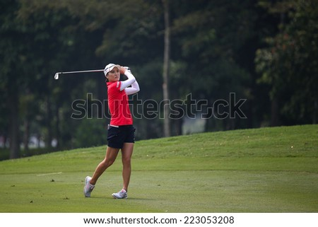 KUALA LUMPUR, MALAYSIA - OCTOBER 10, 2014: So Yeon Ryu Ji of South Korea plays on the fairway of the ninth hole of the KL Golf & Country Club at the 2014 Sime Darby LPGA Malaysia golf tournament.