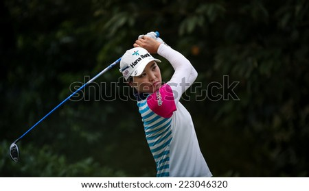 KUALA LUMPUR, MALAYSIA - OCTOBER 11, 2014: So Yeon Ryu of South Korea tees off at the fourth hole of the KL Golf & Country Club during the 2014 Sime Darby LPGA Malaysia golf tournament. - stock photo