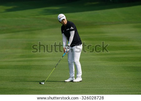 KUALA LUMPUR, MALAYSIA - OCTOBER 09, 2015: South Korea's Eun-Hee Ji prepares to hit from fairway of the 6th hole at the KL Golf & Country Club at the 2015 Sime Darby LPGA Malaysia golf tournament. - stock photo