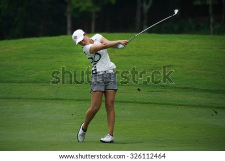 KUALA LUMPUR, MALAYSIA - OCTOBER 09, 2015: South Korea's Min Lee plays from the 6th hole fairway at the KL Golf & Country Club at the 2015 Sime Darby LPGA Malaysia golf tournament. - stock photo