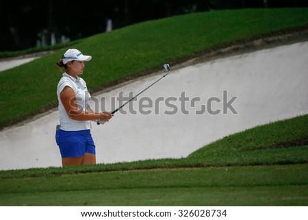 KUALA LUMPUR, MALAYSIA - OCTOBER 09, 2015: South Korea's Mirim Lee plays from 6th hole sand bunker of the Kuala Lumpur Golf & Country Club at the 2015 Sime Darby LPGA Malaysia golf tournament. - stock photo