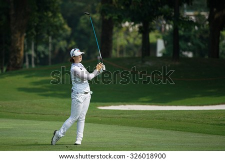KUALA LUMPUR, MALAYSIA - OCTOBER 09, 2015: South Korea's Q Baek plays her shot from the sixth hole fairway of the KL Golf & Country Club at the 2015 Sime Darby LPGA Malaysia golf tournament.