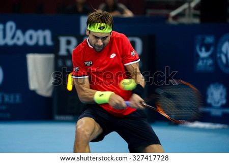 KUALA LUMPUR, MALAYSIA - OCTOBER 03, 2015: Spain's tennis player David Ferrer plays a backhand return at the 2015 Malaysian Open tennis tournament from Sep 26 - Oct 4, 2015 in Stadium Putra. - stock photo