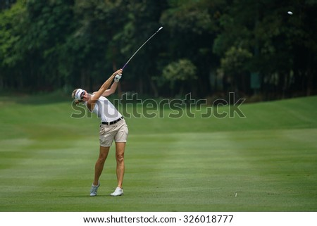 KUALA LUMPUR, MALAYSIA - OCTOBER 09, 2015: USA's Kris Tamulis plays her shot on the sixth hole fairway of the KL Golf & Country Club at the 2015 Sime Darby LPGA Malaysia golf tournament.