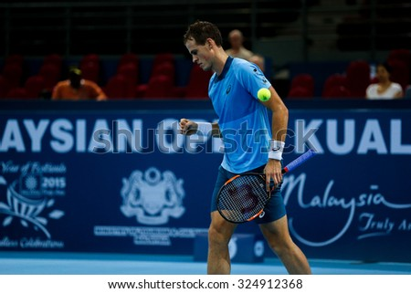 KUALA LUMPUR, MALAYSIA - OCTOBER 01, 2015: Vasek Pospisil of Canada reacts after scoring a point during his match at the Malaysian Open 2015 Tennis tournament held at the Putra Stadium, Malaysia. - stock photo