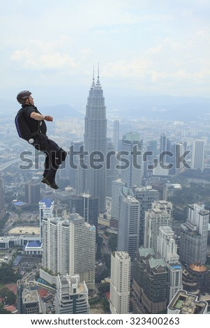 Kuala Lumpur, Malaysia-September 30, 2011: A BASE jumpers in jumps off from KL Tower. KL Tower BASE Jump is an annually event and participants from experienced BASE jumpers from all around the world.