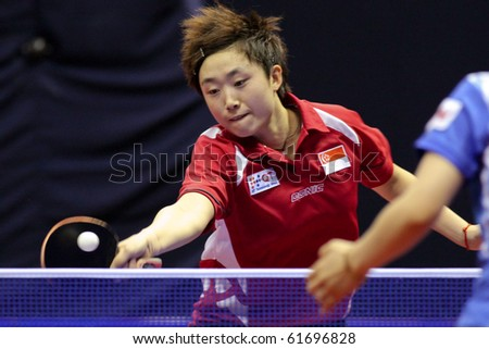 KUALA LUMPUR, MALAYSIA - SEPTEMBER 24: Feng Tianwei of Singapore (ITTF World Rank 2) executes a return at the Volkswagen 2010 Women's World Cup in table tennis on September 24, 2010 in Kuala Lumpur. - stock photo