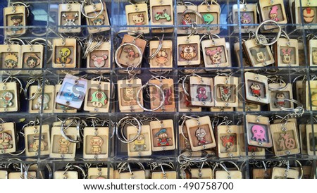 KUALA LUMPUR, MALAYSIA -SEPTEMBER 23, 2016: Key chain made of wood and each carved with images of popular cartoon characters.