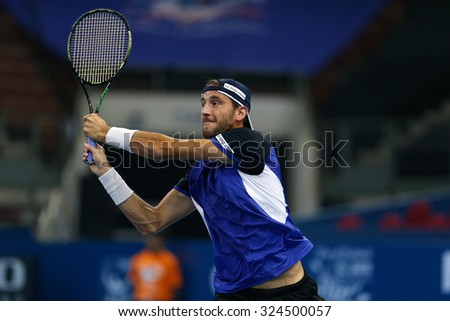 KUALA LUMPUR, MALAYSIA - SEPTEMBER 26, 2015: Luca Vanni of Italy plays his qualifying match in the Malaysian Open 2015 Tennis tournament held at the Putra Stadium, Malaysia.